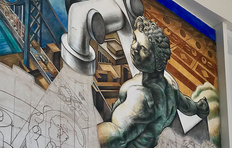 Close up of a mural with a man holding a globe in one hand next to a faucet