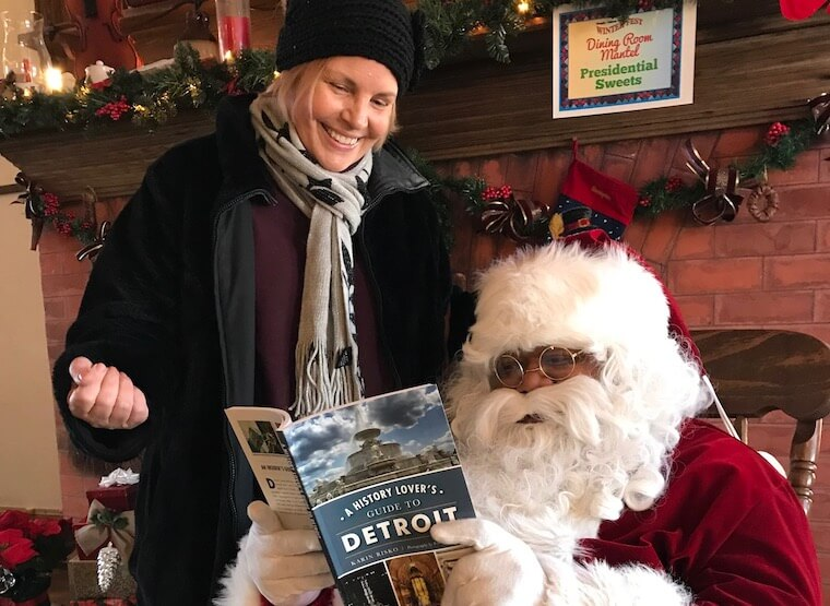 Santa and founder Karin reading her book together