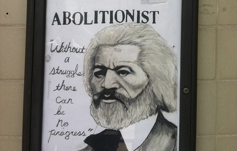 Poster of Frederick Douglass reading 'Abolitionist' and below it 'Without a struggle there can be no progress'