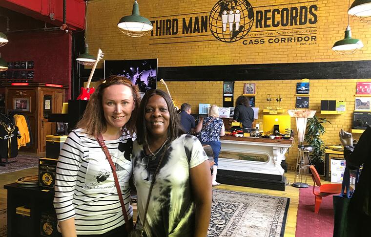 Two women posing at Third Man Records