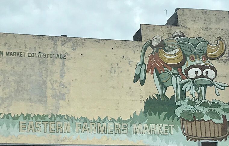 Mural of a cow made of fruits and vegetables at the Eastern Farmers Market